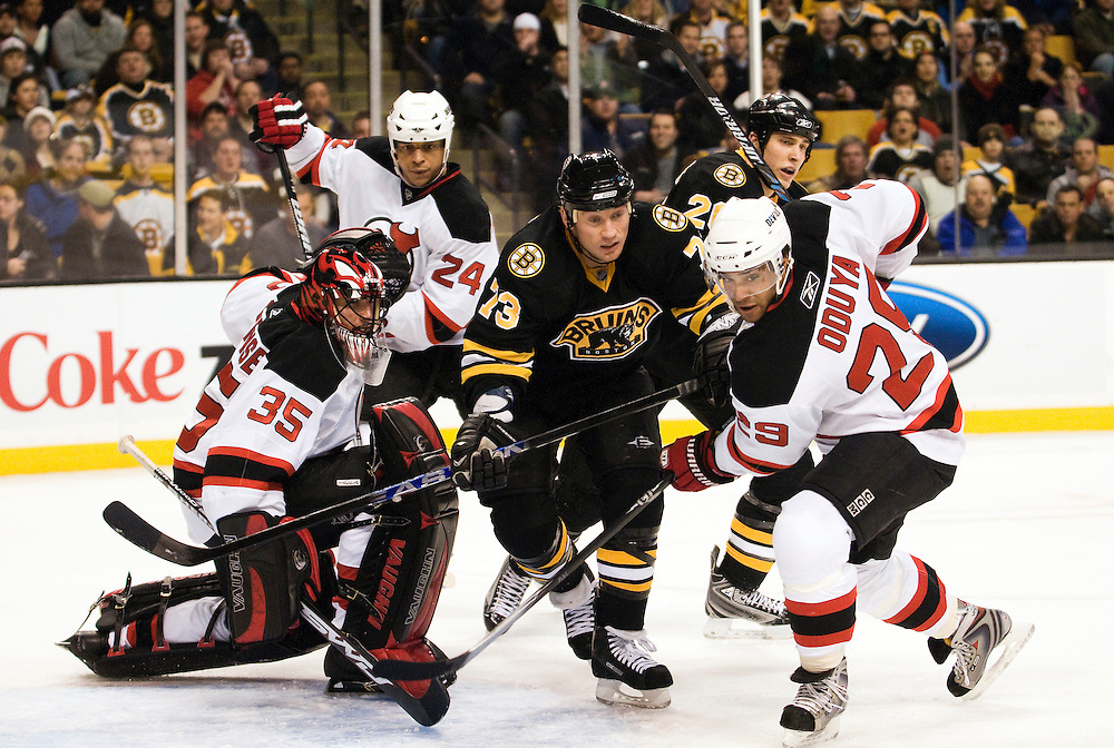 29 January 2009: Devils Golaie Scott Clemmensen #35, Devils defensemen Bryce Salvador #24, Devils defensemen John Oduya #29 and Bruins forward Michael Ryder #73 watch the puck sail into the corner of the ice after a shot during the game between the New Jersey Devils and the Boston Bruins at the TD Banknorth Garden in Boston, MA.*****Editorial Usage Only*****