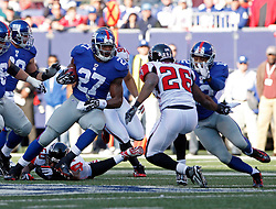 Nov 22, 2009; East Rutherford, NJ, USA; New York Giants running back Brandon Jacobs (27) rushes with the ball during the first half of their game against the Atlanta Falcons at Giants Stadium. Mandatory Credit: Ed Mulholland