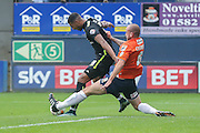 Luton Town defender Scott Cuthbert  with a last ditch tackle on York City forward Vadaine Oliver during the Sky Bet League 2 match between Luton Town and York City at Kenilworth Road, Luton, England on 10 October 2015. Photo by Simon Davies.