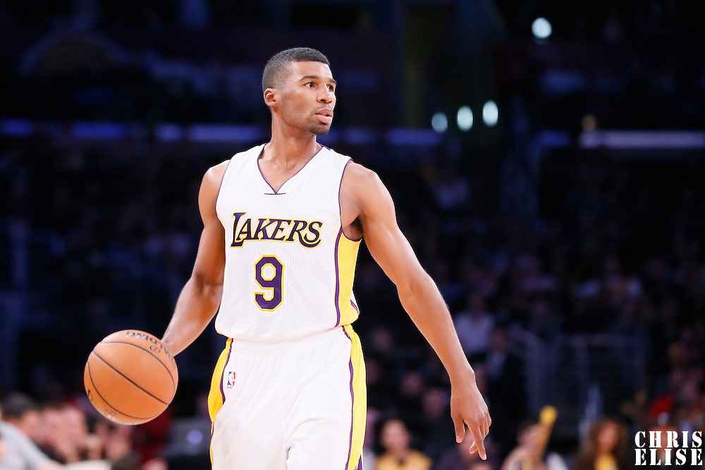 30 November 2014: Los Angeles Lakers guard Ronnie Price (9) brings the ball up court during the Los Angeles Lakers 129-122 overtime victory over the Toronto Raptors, at the Staples Center, Los Angeles, California, USA.