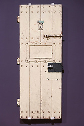 © Licensed to London News Pictures. 03/04/2017. (L to R)  Oscar Wilde's prison door from Reading prison cell showing as part of Tate Britain's Queer British Art exhibition. London, UK. Photo credit: Ray Tang/LNP