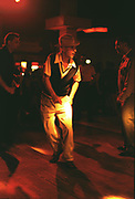 Man in a trilby hat dancing in a club, London, 1990's