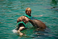 Playing with dolphins at Ocean World, Dominican Republic..Photo by Owen Franken.