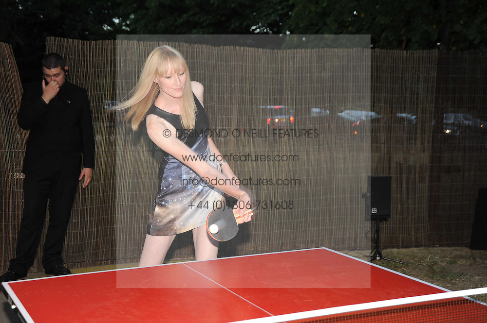 JADE PARFITT playing Table Tennis at the annual Serpentine Gallery Summer party this year sponsored by Jaguar held at the Serpentine Gallery, Kensington Gardens, London on 8th July 2010.  2010 marks the 40th anniversary of the Serpentine Gallery and the 10th Pavilion.