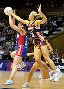 Laura Geitz spoils the incoming pass to Megan Dehn ~ Netball action from ANZ Championship Grand Final - Queensland Firebirds v Northern Mystics - played at the Brisbane Convention Centre on Sunday 22nd May 2011 ~ Photo : Steven Hight (AURA Images) / Photosport
