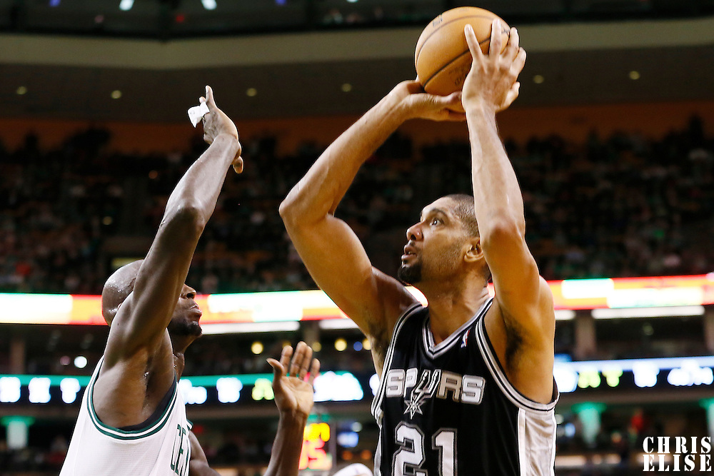 21 November 2012: San Antonio Spurs power forward Tim Duncan (21) takes a jumpshot over Boston Celtics power forward Kevin Garnett (5) during the San Antonio Spurs 112-100 victory over the Boston Celtics at the TD Garden, Boston, Massachusetts, USA.