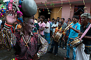 Kavadi dancer with a pot on his head at a small street Hindu festival off Jampettah Street in Colombo 13.