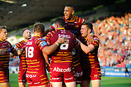 Aaron Murphy (C) of Huddersfield Giants celebrates  scoring the try with team mates against  Hull FC during the Betfred Super League match at the John Smiths Stadium, Huddersfield<br /> Picture by Stephen Gaunt/Focus Images Ltd +447904 833202<br /> 05/07/2018