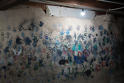 3 October 2018, Jerusalem, Occupied Palestinian Territories: School children's hands decorate the wall of the school in Khan al Ahmar. Khan al Ahmar is a Bedouin community located within the East Jerusalem Periphery, in E1 area. It is home to 32 families, 173 persons in total, including 92 children and youths. The community has a mosque and a school, which was built in 2009 and serves more than 150 children between the ages of six and fifteen, from Khan al Ahmar and other nearby communities. With due date 1 October 2018, Israeli authorities threaten to demolish the site, thereby making room for nearby Israeli settlements to expand.