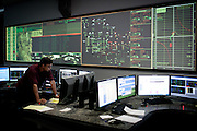 Sirajul Chowdhury, left, trains in a simulated control room at the California Independent System Operator in Folsom, Calif., October 19, 2011.