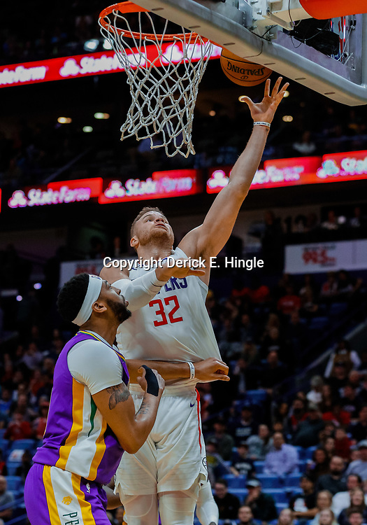 Jan 28, 2018; New Orleans, LA, USA; LA Clippers forward Blake Griffin (32) shoots over New Orleans Pelicans forward Anthony Davis (23) during the second quarter at the Smoothie King Center. Mandatory Credit: Derick E. Hingle-USA TODAY Sports