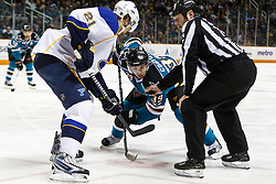 March 19, 2011; San Jose, CA, USA;  NHL linesman Lonnie Cameron (74) drops the puck on a face off to San Jose Sharks center Logan Couture (39) and St. Louis Blues center Patrik Berglund (21) during the first period at HP Pavilion. San Jose defeated St. Louis 5-3. Mandatory Credit: Jason O. Watson / US PRESSWIRE
