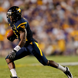 Sep 25, 2010; Baton Rouge, LA, USA; West Virginia Mountaineers wide receiver Tavon Austin (1) runs after a reception against the LSU Tigers during the second half at Tiger Stadium. LSU defeated West Virginia 20-14.  Mandatory Credit: Derick E. Hingle