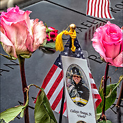 On the 15th anniversary of 9-11 at Ground Zero, flowers placed on the memorial plagues  by a loved ones by the name of Calixto Anaya, Jr. &quot;Charlie&quot;  fireman and Marine who died that day.<br /> <br /> The 2,983 names of the victims of the attacks of Sept. 11, 2001, and Feb. 26, 1993, World Trade Center truck bombing are inscribed into bronze parapets surrounding the twin memorial pools.