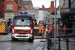"""© Licensed to London News Pictures. 16/11/2019. Bolton, UK. Firefighters work at the scene where a fire broke out overnight (15th/16th November 2019) at a block of flats known as """" The Cube """" , in Bolton Town Centre . At least two people are known to have been treated by paramedics at the scene of the six-story , block which is occupied by students of the University of Bolton . Photo credit: Joel Goodman/LNP"""