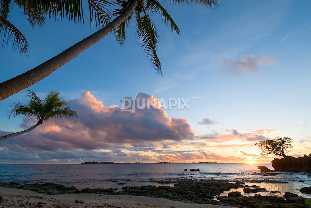 Sunset at Kerehikapa Island, view towards Sikopo Island.