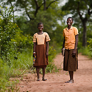 Lutufie (right) and Nasiha, pictured on 27 May 2014, walk three kilometres to school everyday in the Upper West region of Ghana.