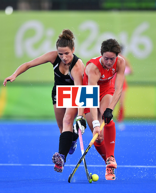 New Zealand's Pippa Hayward (L) vies with Britain's Hannah Macleod during the women's semifinal field hockey New Zealand vs Britain match of the Rio 2016 Olympics Games at the Olympic Hockey Centre in Rio de Janeiro on August 17, 2016. / AFP / MANAN VATSYAYANA        (Photo credit should read MANAN VATSYAYANA/AFP/Getty Images)