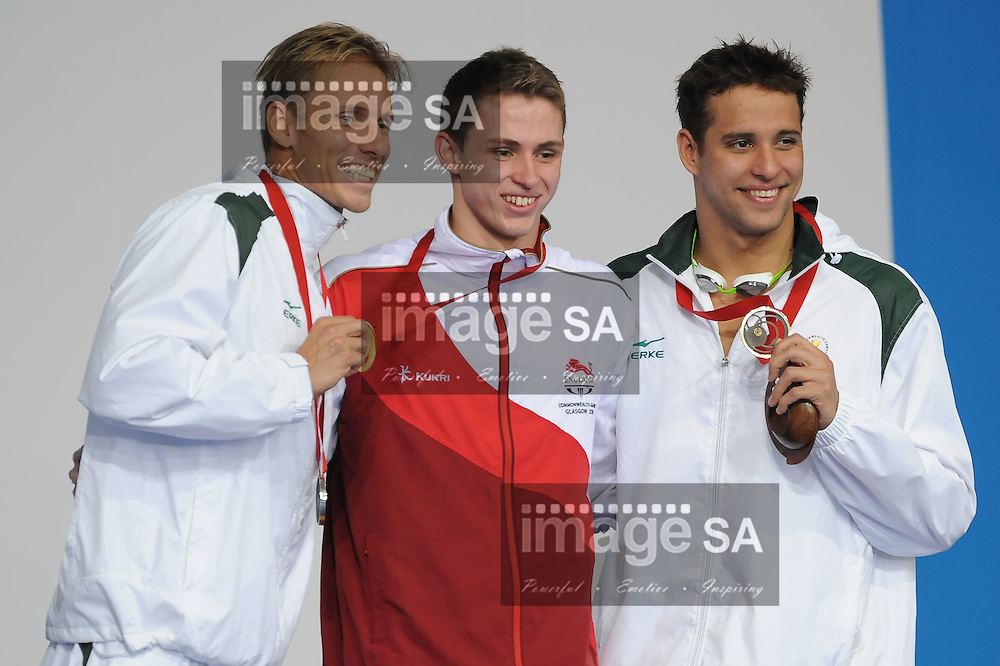 GLASGOW, SCOTLAND - JULY 25: Roland Schoeman of South Africa, Benjamin Proud of England  and Chad le Clos during the medal ceremony of the mens 50m butterfly on day 2 of the 20th Commonwealth Games at Tollcross Swimming Centre on July 25, 2014 in Glasgow, Scotland. (Photo by Roger Sedres/ImageSA)