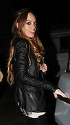 28.FEB.2009 - LONDON<br /> <br /> A HAPPY LINDSAY LOHAN LEAVING HER RESIDENCE IN CHELSEA AT 9.30PM WITH GIRLFRIEND SAM RONSON WITH A COUPLE OF DVD'S THEY TOOK TO A FRIENDS HOUSE TO CHILL OUT, THEY THEN HEADED ONTO BUNGALO 8 CLUB TO MEET SAM'S BROTHER MARK AND DANIEL MERRYWETHER WHERE THEY PARTIED TILL 3.30AM AND THEN WENT ONTO A FRIENDS HOUSE IN SHOREDITCH WITH MARK. MARK THEN LEFT WITH A MYSTERY GIRL AT 4.30AM BEFORE LINDSEY AND SAM HAD ONE OF THERE LEGENDRY ARGUMENTS SCREAMING AT EACHOTHER INSIDE THE HOUSE UNTILL THEY LEFT AT 6.00AM WITH THERE HANDS COVERING THERE FACE, THEN WHEN THEY GOT BACK TO THERE HOUSE THEY WERE AGAIN SCREAMING AT EACHOTHER BEFORE LINDSEY CAME OUT THE CAR CRYING AND WIPING HER EYES. THE ARGUMENT  DIDNT STOP THOUGH AS THEY CONTINUED THE ARGUMENT INSIDE THE HOUSE AND YOU COULD HEAR THEM SHOUTING ABUSE AT EACHOTHER FROM OUTSIDE THE HOUSE THIS CONTINUED TILL 8.30AM BEFORE IT ALL WENT QUITE.<br /> <br /> BYLINE MUST READ : BLOOMS/EDBIMAGEARCHIVE.COM<br /> <br /> *THIS IMAGE IS STRICTLY FOR MAGAZINE AND WORLDWIDE SALES ONLY*<br /> *FOR UK NEWSPAPER OR WEB USE PLEASE CONTACT EDBIMAGEARCHIVE-0208 954-5968*