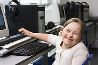 Portrait of girl (10-12) with Down syndrome in home  recording studio