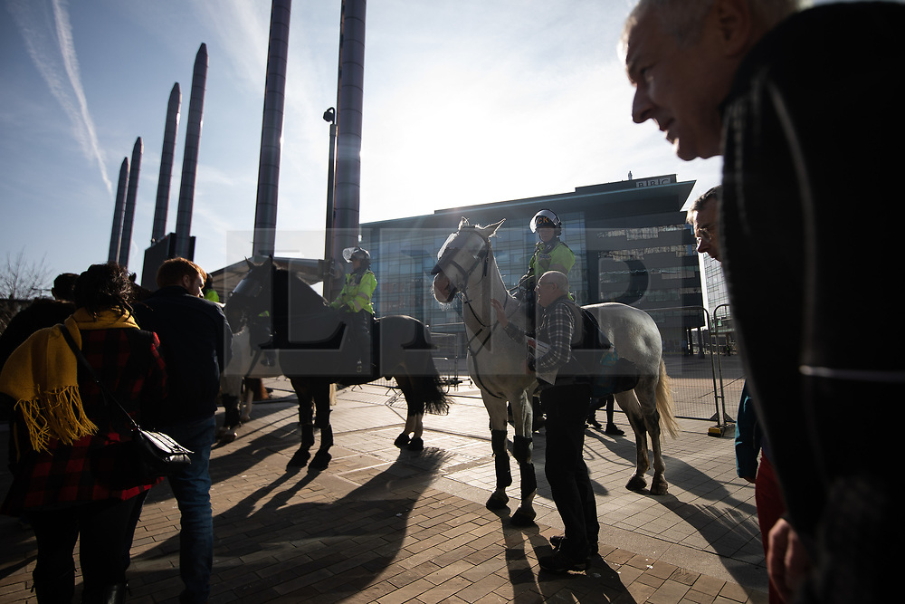 """© Licensed to London News Pictures . 23/02/2019. Salford, UK. Mounted police in front of the BBC at Media City . Supporters of Tommy Robinson (real name Stephen Yaxley-Lennon ) and anti-fascists opposed to the former EDL leader and his followers , gather near to the BBC at Media City to protest , as Yaxley-Lennon hosts a rally showing a home-made documentary , """" Panodrama """" , described as an exposé of the BBC's Panorama documentary series . A BBC Panorama documentary is due to feature an investigation in to Yaxley-Lennon in the near future . Photo credit: Joel Goodman/LNP"""