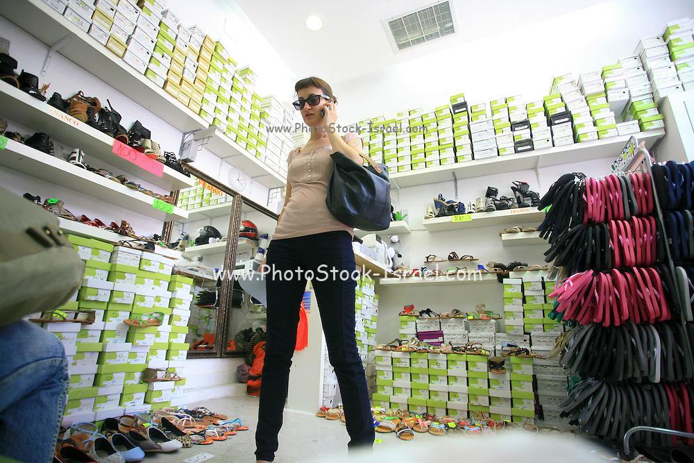 Woman in a shoe store at Sheinkin street, Tel Aviv.