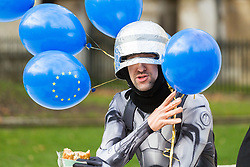 """""""Robocop"""", an anti-Brexit campaigner has a break to eat his lunch. London, January 14 2019."""