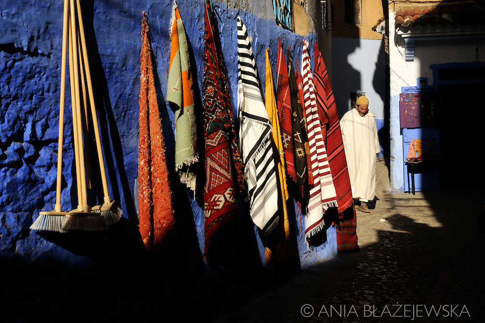 Morocco, Chefchaouen. Man walking the street of the blue medina.