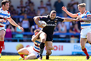 Bradford Bulls winger Omari Caro (18) is tackled during the Kingstone Press Championship match between Rochdale Hornets and Bradford Bulls at Spotland, Rochdale, England on 18 June 2017. Photo by Simon Davies.