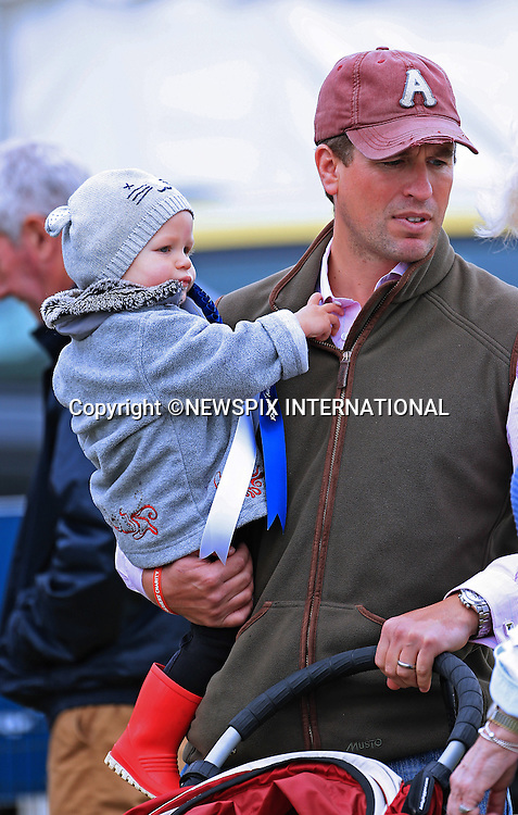 PETER PHILLIPS AND DAUGHTER ISLA<br /> have a family day out at the Gatcombe Horse Trials, held on Princess Anne's home Gatcombe Park, Minchinhampton_21/09/2013.<br /> Mandatory Credit Photo: &copy;NEWSPIX INTERNATIONAL<br /> <br /> **ALL FEES PAYABLE TO: &quot;NEWSPIX INTERNATIONAL&quot;**<br /> <br /> IMMEDIATE CONFIRMATION OF USAGE REQUIRED:<br /> Newspix International, 31 Chinnery Hill, Bishop's Stortford, ENGLAND CM23 3PS<br /> Tel:+441279 324672  ; Fax: +441279656877<br /> Mobile:  07775681153<br /> e-mail: info@newspixinternational.co.uk