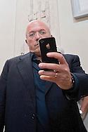 Roma, 11  Luglio 2012.Consiglio comunale in Campidoglio nell'aula Giulio Cesare per  la discussione sulla  cessione del 21% della controllata Acea, l'azienda che si occupa di acqua e servizi. Francesco Storace, La Destra fotografa il fotografo con iphone