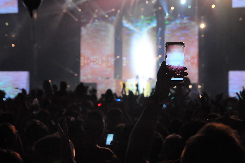 A phone from the deep crowd capturing a moment at Ile Soniq.