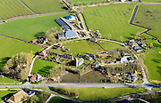 Nederland, Friesland, gemeente Dongeradeel, 28-02-2016; Foudgum met boerderijen-kring rond de romaanse Mariakerk.<br /> Small village, farms in circle around the church, very North of Friesland.<br />  <br /> luchtfoto (toeslag op standard tarieven);<br /> aerial photo (additional fee required);<br /> copyright foto/photo Siebe Swart