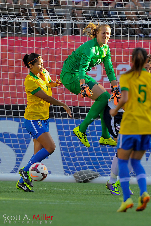 Brazil goalkeeper Luciana (12) goes airborne for a save on the ball during an international friendly against the United States at the Florida Citrus Bowl on Nov. 10, 2013 in Orlando, Florida. The U.S. won 4-1.<br /> <br /> <br /> &copy;2013 Scott A. Miller