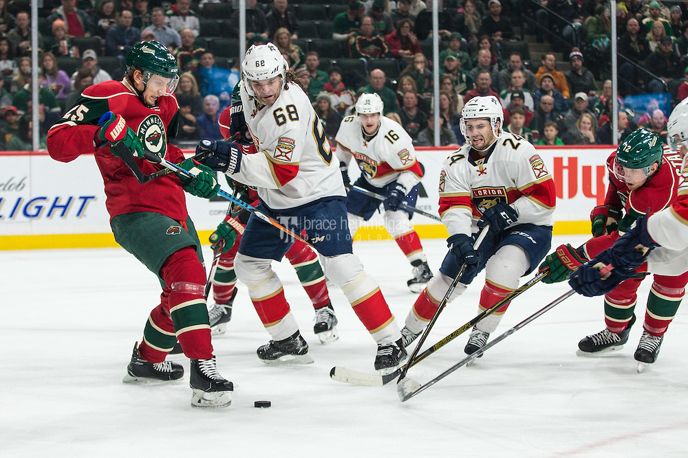 Dec 13, 2016; Saint Paul, MN, USA; Florida Panthers forward Jaromir Jagr (68) and forward Seth Griffith (24) go for a loose puck against Minnesota Wild defenseman Jonas Brodin (25) during the first period at Xcel Energy Center. Mandatory Credit: Brace Hemmelgarn-USA TODAY Sports