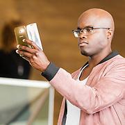 NLD/Amsterdam/20160829 - Seizoenspresentatie RTL 2016 / 2017, Jandino Asporaat maakt een selfie met zijn iphone