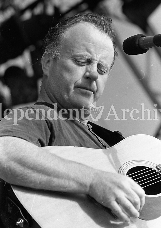 Headlining act Christy Moore performing during the Feile Festival in Thurles, 01/08/1990 (Part of the Independent Newspapers Ireland/NLI Collection).
