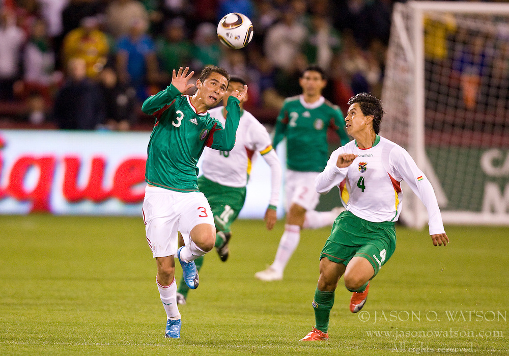February 24, 2010; San Francisco, CA, USA;  Mexico defender Paul Aguilar (3) heads the ball away from Bolivia defender Marvin Bejarano (4) during the first half at Candlestick Park. Mexico defeated Bolivia 5-0.