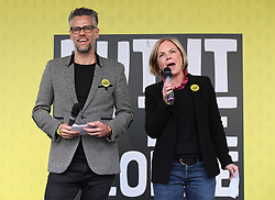 Richard Bacon and Mariella Frostrup address anti-Brexit campaigners in Parliament Square as they take part in the People's Vote March in London.
