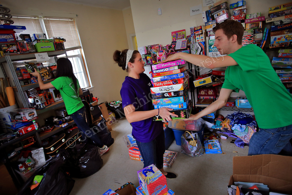 From left: Amy Yu, of Grand Blanc, Katherine Jabboury, of Troy, and Tod Carnish, of Mentor, OH, work together to sort sports and game donations in an area of the house. They were among eleven CMU students volunteering during her Alternative Break at the Carolina Youth Development Center in North Charleston, SC, spending the week to help with projects to improve the center and in the community.  CMU is ranked fourth in the nation for the number of students participating in Alternative Breaks and fifth in the country for the most trips coordinated by a university. The program organizes about 40 trips each year with more than 400 students participating. Photo by Steve Jessmore/Central Michigan University