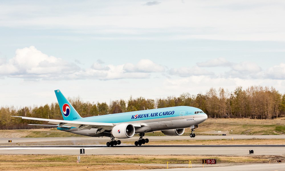 Korean Air Cargo jet landing at Ted Stevens Anchorage International Airport in Southcentral Alaska. Spring. Afternoon.