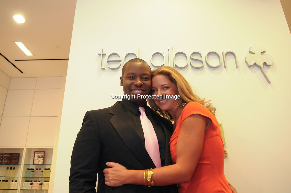 "090924-CHEVYCHASE-Mary Amons(R), a cast member of the up and coming Bravo show ""The Real Housewives of DC,""  pose for a photo with stylist Ted Gibson(L) during the grand opening of his new salon in Chevy Chase, Md on September 24, 2009."