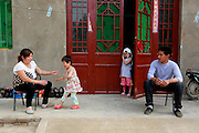 FENGQIU COUNTY, CHINA - (CHINA OUT) <br /> <br /> 5-Year-Old Girl Has Never Worn Dress Due To Her Black Patch<br /> <br /> Mengmeng, a 5-year-old girl with a giant black patch of melanocytic nevi on her midsection, sits on a chair on May 24, 2014 in Fengqiu County, Henan Province of China. After three years of infertility, Wang Yanna finally gave birth to her first child, Mengmeng, only to find a giant black patch of melanocytic nevi on her midsection. Mengmeng, 5-year-old daughter of Liu Weikai and Wang Yanna from Fengqiu County, is willing to go through pain to get rid of the patch. During a laser operation, Mengmeng cried in pain yet still would not let them stop. Although doctors were able to get rid of the lumps that formed on Mengmeng\'s black patch, none of them knew what to do with the patch itself. Since the patch may become cancerous, Mengmeng\'s parents are worried it will be a threat to their daughter\'s life. Several experts have suggested to graft off the skin but the operation would require hundreds of thousands of dollars, which is unrealistic for Mengmeng\'s family. Mengmeng currently does not go to school, only plays at her front door, and has never worn a dress.<br />  ©Exclusivepix
