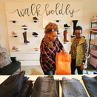 Peggy Grice and Mable Warren, of Baldwyn, shop at the Three Eleven Boutique in downtown Baldwyn on Thursday morning. The city of Baldwyn is introducing monthly Pop Up Market Shops to spur business downtown.