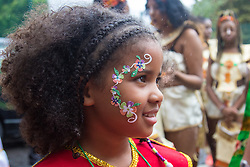 London, August 28th 2016. A little girl displays her facial sticker as Europe's biggest street party, the Notting Hill Carnival gets underway.