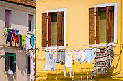 Colorful houses and laundry hanging to dry, Burano, Veneto, Italy