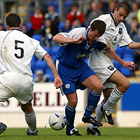 St Johnstone v Ross County..  21.09.02<br />Chris Hay is crowded out by Brian Irvine and Graham Bayne<br /><br />Pic by Graeme Hart<br />Copyright Perthshire Picture Agency<br />Tel: 01738 623350 / 07990 594431