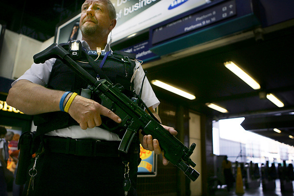 LONDON, ENGLAND, 10/08/05 PC John Graef, on guard in London Bridge station. by Neville Elder.