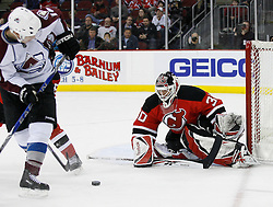 Feb 26, 2009; Newark, NJ, USA; New Jersey Devils goalie Martin Brodeur (30) makes a save during the third period at the Prudential Center. The Devils defeated the Avalanche 4-0.